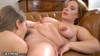 Tiffany Tatum making lesbian love with chubby MILF